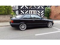 Black 3 Series Coupe (E36) with 5-Series Wheels