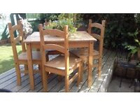 Pine table and 4 chairs for sale. Used condition with some wear and tear but good quality.