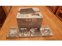 Play Station 3 Slim Boxed in excellent condition with games