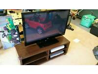 "Lg 42"" tv and stand, sky box and dvd player"