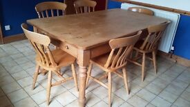 Solid large pine table and 6 chairs.