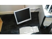 monitor, keyboard, speakers and mouse