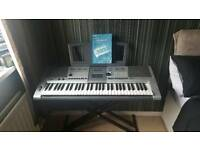 Yamaha Keyboard psr -e403 + With dual stand.