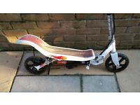 Space scooter, can be used as normal or treadle action to drive rear wheel