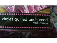 Purple quilted bedspread