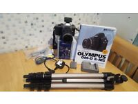 Olympus om-d e-m5 mirrorless camera with kit lens, spare battery, manual and tripod