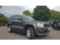 Jeep Grand Cherokee - 5.7l HEMI - low miles and great condition