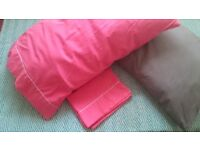 2 sleeping pillows with covers