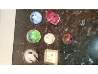 Paperweights. Seven assorted glass paperweights.