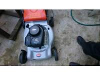 Petrol lawnmower servicing or repairs