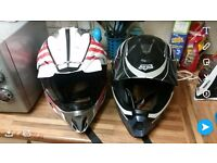 2 x motocross helmets think ther both medium or possibly one small fox