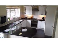 Complete Kitchen - White High Gloss units and Black Marble effect worktops all in good condition