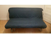 For sale an Ikea sofa bed with blue Denim cover