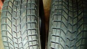 Two Firestone  265 70 17 winter tires