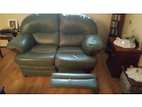 Leather two and three seater couch and poufee