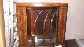 Walnut bow fronted display cabinet