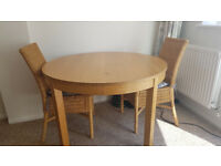 Round extendable IKEA wooden dining table