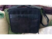 Black Dell Laptop Bag with shoulder strap and lots of compartments - New - never been used.