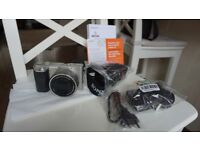 Sony A6000 silver like new with warranty