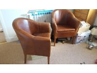 2 Brown leather chairs in great condition