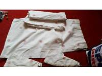 """Pair of white curtains with pink flower detail 50""""L by 58""""W"""