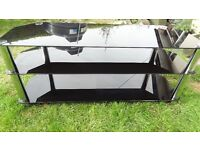 "tv stand gloss black glass and chrome suitable for 50"" tv large in size"