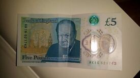 Five pound note with reference starting with AK16