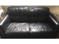 Black leather sofas. REDUCED TO £40 !!Need gone asap