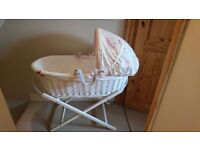 Pink lining moses basket and stand