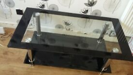 Glass coffee table in good condition.