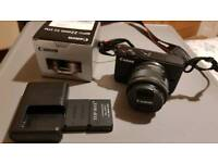 Canon EOS M10 with lenses, batteries and charger - immaculate condition