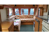 abbey swift 2 berth separate end washroom/ shower room/ toilet ,l-shaped lounge