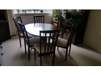 Balmoral Mahogany dining table, round to oval with 6 chairs