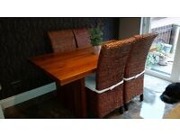 ACACIA WOOD DINING TABLE AND 4 RATTAN DINING CHAIRS
