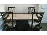Solid marble dining table and four chairs. Cream and brown.