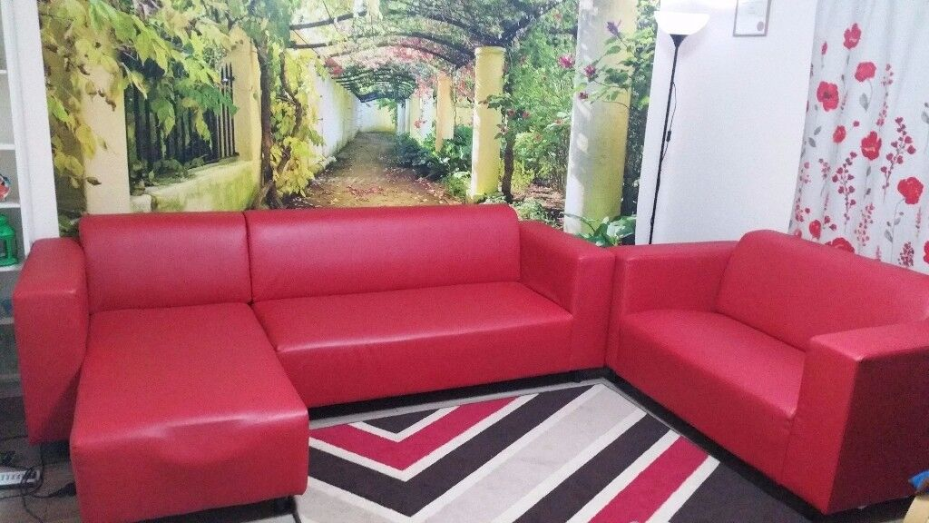 Two red leather sofas (corner 3-seat + 2-seat) in good condition
