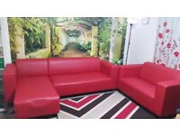 Two red leather sofas (corner 3-seat + 2-seat) in excellent condition