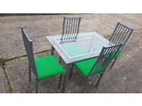 Glass dining table and chairs - can deliver