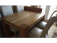 Solid Oak Dining Table with Four Cream Chairs