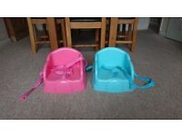 Pink/blue booster seat (s)