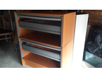 Filing cabinets with tambour roll down fronts