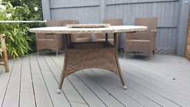 Garden table (NOT CHAIRS) with revolving middle, rattan base