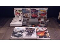 Nintendo wii white in mint condition with 7 games and remote for sale or swap