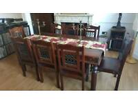 Solid wood handcrafted dining table with chairs