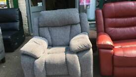 Fabric rocking n manual reclining arm chair as new £ 50
