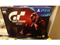 brand new PS4 with Gran Turismo game included still in the box unopened , 500GB ,jet black