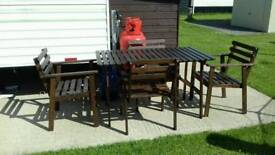 Outdoor table and four chairs.situated in benone.