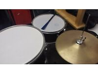 Drum kit suitable for a beginner. Also includes a stool which isn't pictured