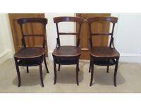 3 chairs - wooden, brown in colour, not antique but probably vintage.