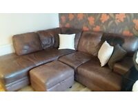 Brown leather corner sofa and matching pouffe with storage